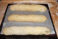 Zubereitung des Rezepts Hefeteig-Strudel mit Mohn- und Nussfüllung, schritt 16