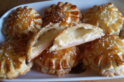 Zubereitung des Rezepts Fantastische und megaschnelle Blätterteig-Blümchen mit Schinken und Käse, schritt 12